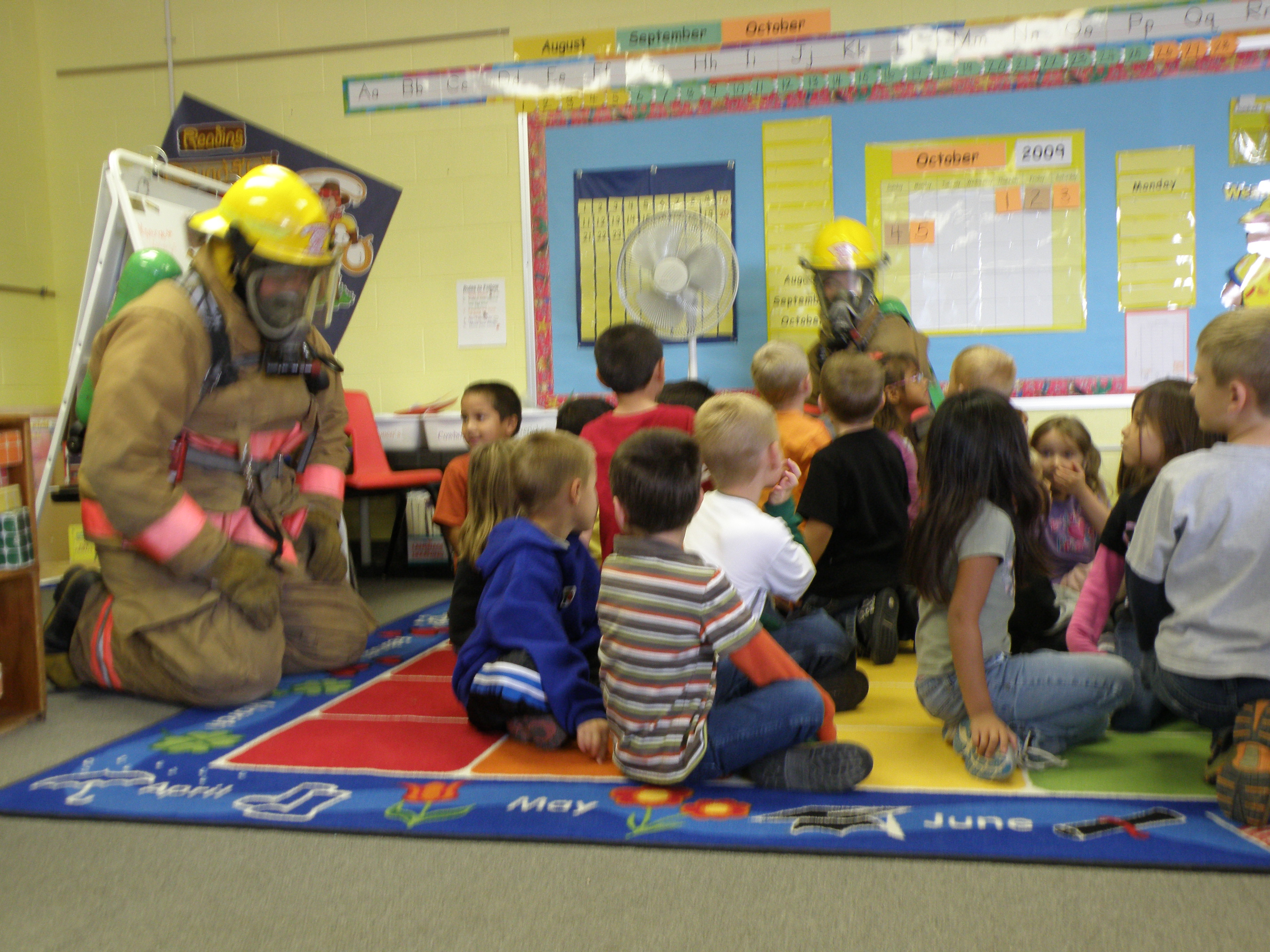 Firefighter Giving a Classroom Demonstration